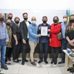 Gestão de Turismo da Unesc recebe homenagem no Balneário Rincão